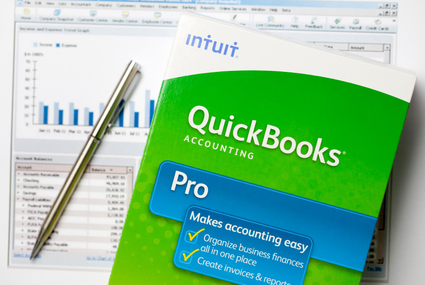 QuickBooks Accounting Pro software package in front of spreadsheet